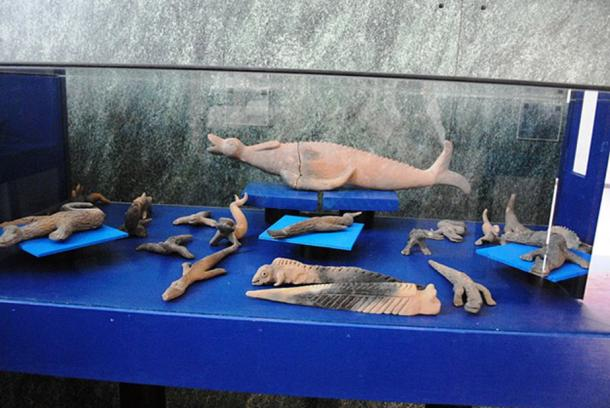 Some of figurines which look like reptiles or sea creatures.