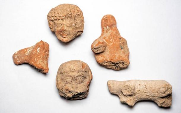 Clay figurines of women and animals found at the Arnona, Jerusalem excavation site. (Yaniv Berman / Israel Antiquities Authority)
