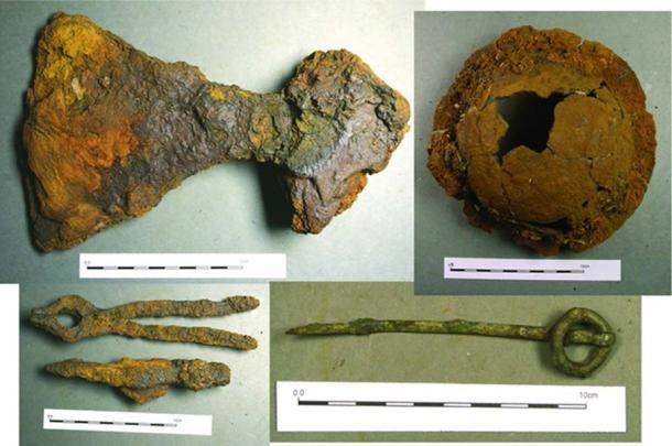 Some of the finds recovered from the grave (clockwise from the top left): broad-bladed axe, shield boss, ringed pin and the hammer and tongs.