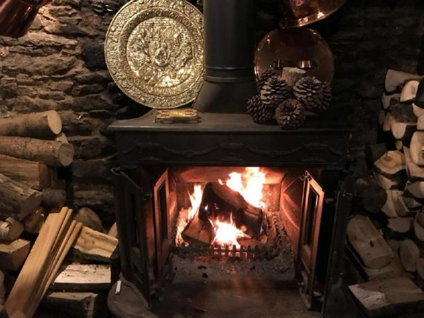 The fireplace in the British pub dates back to the 8th century. (The Old Church House Inn / Facebook)