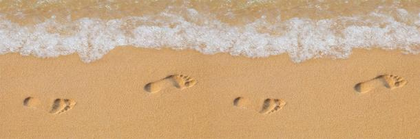 Human footprints in the sand showing the shape of the human foot and arch. (kozlik_mozlik