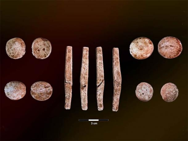 The four sides of a dice, as well as the front and back sides of several other Iron Age game pieces found in western Norway. (University of Bergen)