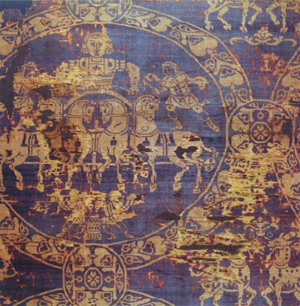 A fragment of the shroud in which the Emperor Charlemagne was buried in 814. It was made of gold and Tyrian purple.