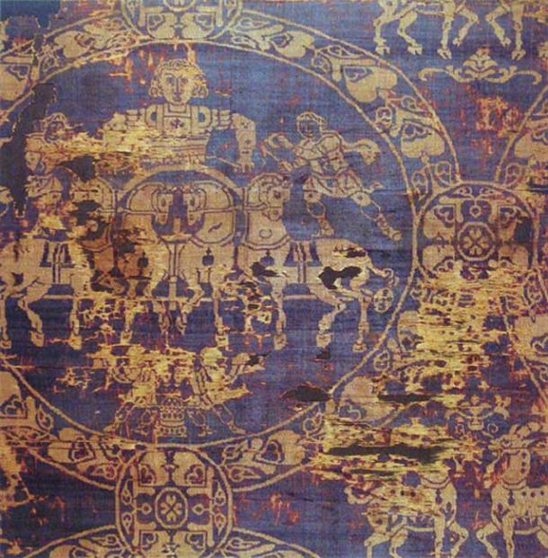 A fragment of the shroud in which the Emperor Charlemagne was buried in 814. It was made of gold and Tyrian purple from Constantinople.