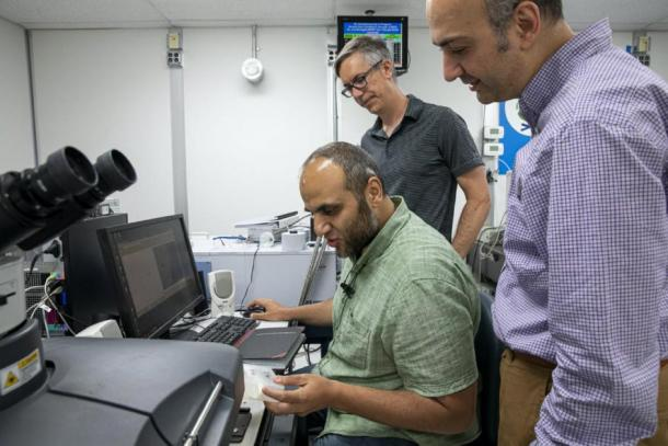 From left, Cairo University postdoctoral researcher Mohamed Kasem, ALS scientist Hans Bechtel, and Cairo University associate professor Ahmed Elnewishy study bone samples at the ALS using infrared light. (Marilyn Sargent/Berkeley Lab)