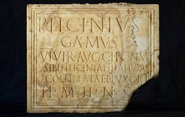 A funerary plaque with the deceased's name and epitaph
