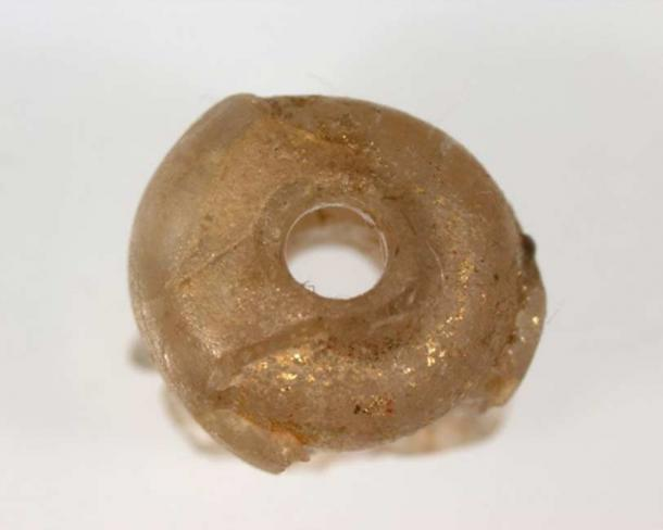 A glass bead that was made by Roman craftsmen - found in an ancient tomb at Nagaokakyo near Kyoto.