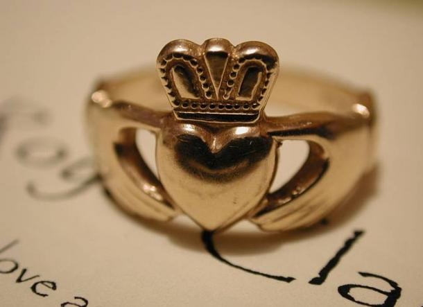 A gold Claddagh ring.