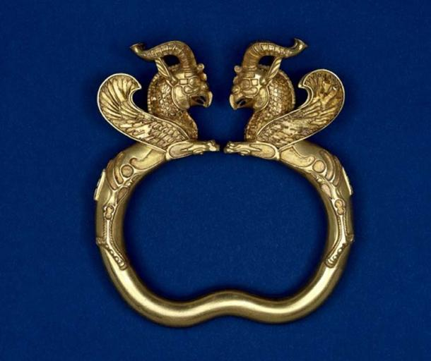 A gold armlet with griffin heads from the Oxus Treasure.
