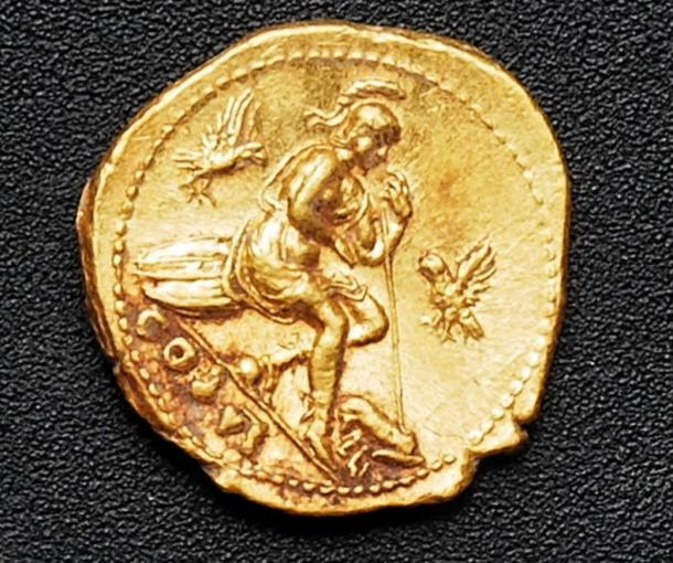 One of the gold coins discovered among the bodies.