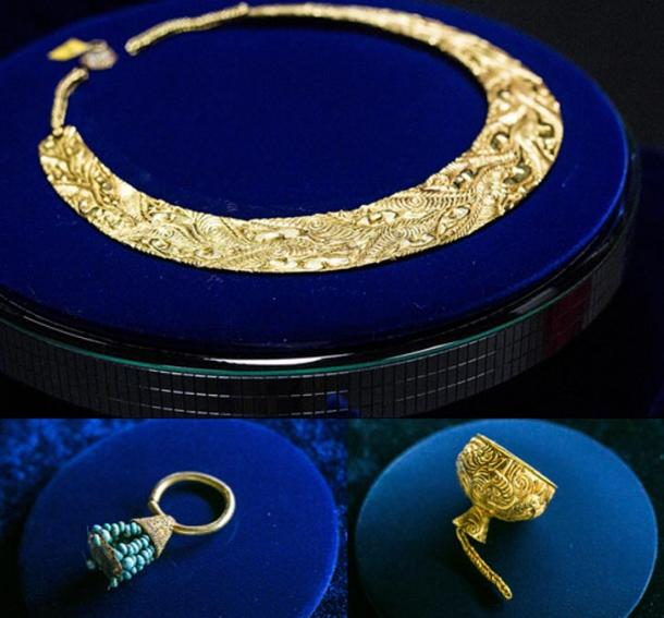 A gold pectoral in Animal Style decoration, golden earring with turquoise and a miniature gold cup.