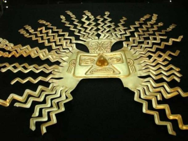 A gold-sheet mask representing the sun god Inti from the La Tolita part of the Inca empire. The design is typical of masks of Inti with zig-zag rays bursting from the head and ending in human faces or figures. National Museum, Quito, Ecuador
