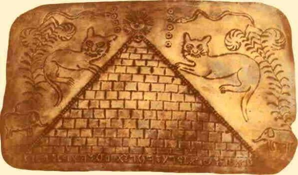 A gold sheet with a picture of a pyramid and Ethiopian letters at the foot of the pyramid. (Author provided)