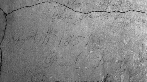 Pencil graffiti found in the secret passage is still visible. (Jessica Taylor / UK Parliament)