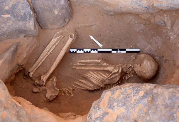 The grave of a young man, buried in an extremely contracted position on his side inside a ring cairn. The well-preserved skeletal remains were radiocarbon-dated to 425–580 AD.