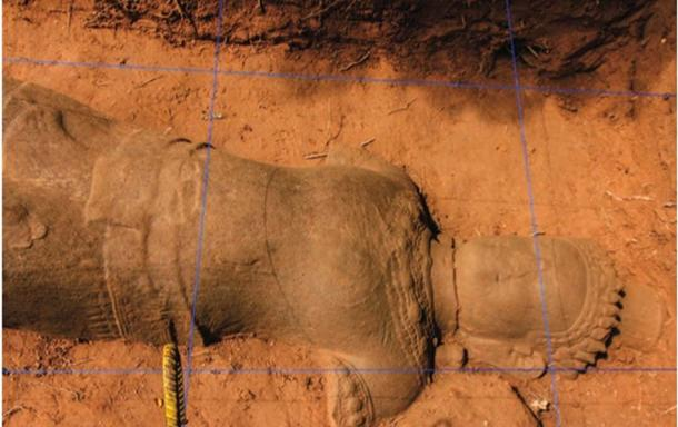Archaeologists made a grid to draw the statue which is in the form of a guard, before moving it. (Image: Apsara Authority)