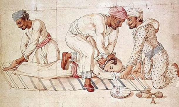 A group of Thugs strangling a traveler on a highway in India in the early 19th century.