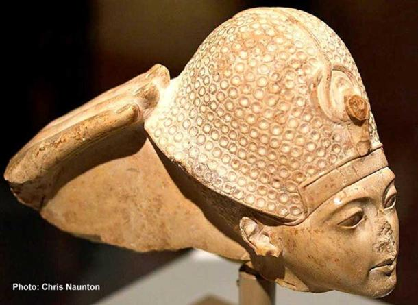 This head of indurated limestone is a fragment from a statue group that represented the god Amun seated on a throne and Tutankhamun standing or kneeling in front of him. All that remains of Amun is his right hand, which touches the back of the king's crown in a gesture that signifies Tutankhamun's investiture as king. Metropolitan Museum of Art, New York.