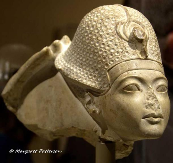 This head of indurated limestone is a fragment from a group statue that represented Amun seated on a throne, and Tutankhamun standing or kneeling in front of him. All that remains of the god is his right hand, which touches the back of the pharaoh's crown in a gesture that signifies his investiture as king. Metropolitan Museum of Art, New York.
