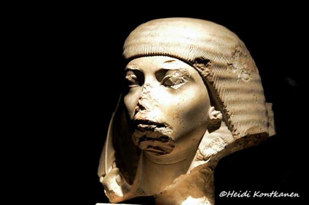 This head, part of a fragmentary monolithic pair statue of husband and wife, represents Nakhtmin, a royal scribe and general under Tutankhamun. He was designated the crown prince when King Aye came to the throne. Along the right-hand side of the wig can be seen the remains of the ostrich plume fan that served as a symbol of his rank. Luxor Museum.