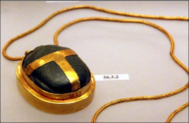 A heart scarab on a necklace.