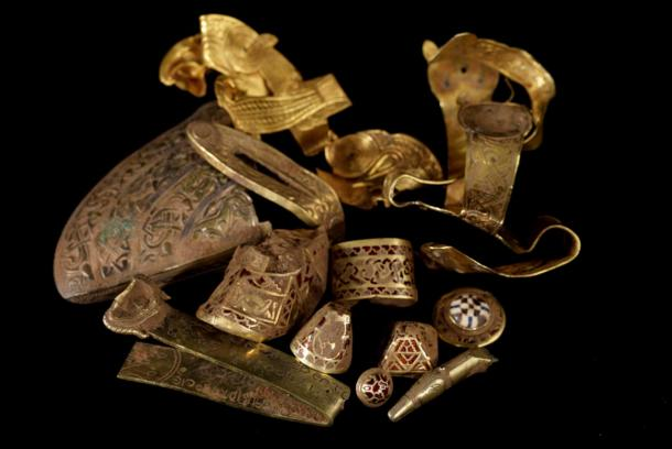 A selection of highlight pieces from the Staffordshire Hoard, uncleaned by conservators, still showing traces of soil.