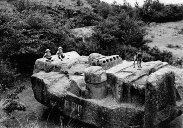 A historical photo of the monolith of Tlaloc in Coatlinchan, Mexico.