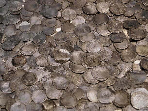 A hoard of silver coins, the latest about 1700. The British Museum.
