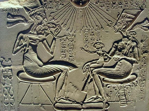 "A ""house altar"" depicting Akhenaten, Nefertiti, and three of their daughters."