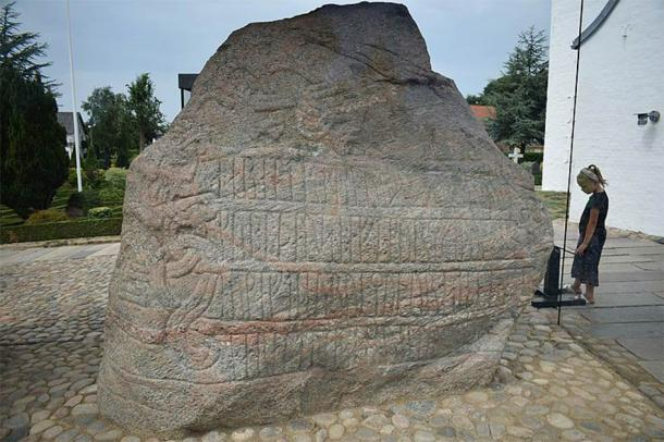 The larger of the Jelling stones, enormous carved runestones found in Jelling, was raised by Harold Bluetooth in 970 to celebrate Denmark's conversion to Christianity. (Ljunie / CC BY-SA)