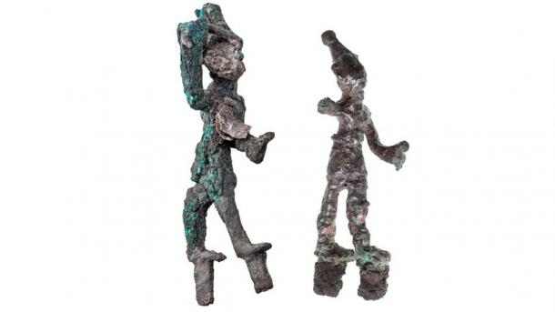 Two tiny figurines depicting 'smiting gods' (could be Baal and Resheph) that were found by the altar of the Canaanite temple. (Tal Rogovski / Hebrew University of Jerusalem)