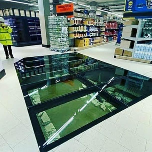 The completed glass floor and the Hiberno-Norse structure underneath in the new Lidl supermarket in central Dublin, Ireland designed by the Irish Archaeological Consultancy Ltd. (Andrew Finney)