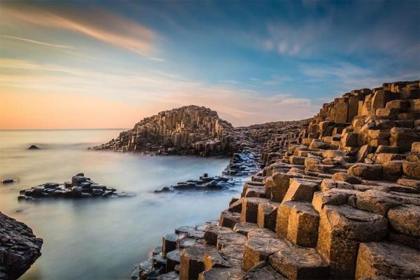 The Giant's Causeway in the evening light. Credit: Ossie / Adobe Stock