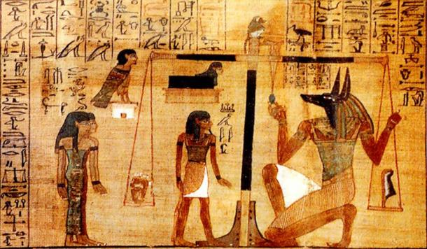 The weighing of the deceased's heart against Maat's feather on a scale from Chapter 25 (detail) of the Egyptian Book of the Dead. (Public domain)