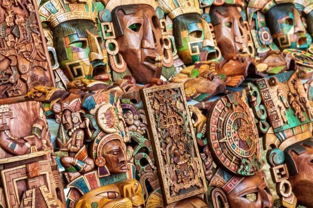 Maya wooden handcrafted masks in a traditional Mexican market. (Jose Ignacio Soto / Adobe stock)