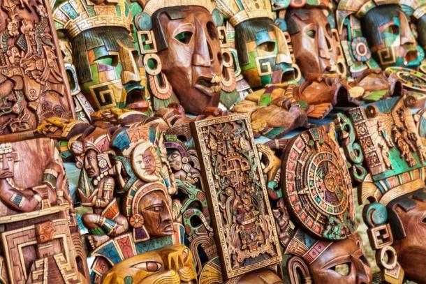 Maya wooden handcrafted masks in a traditional Mexican market. (Jose Ignacio Soto / Adobe stock)