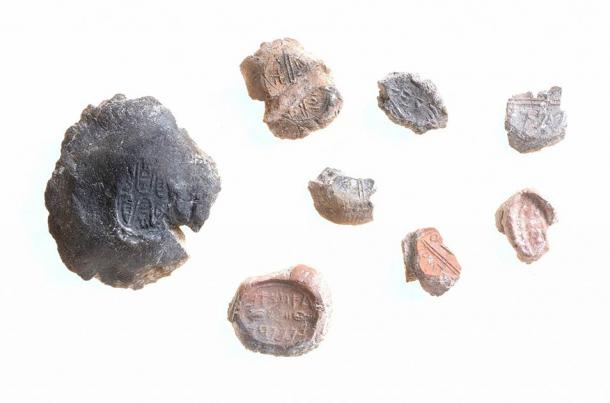 """A collection of """"typical"""" bulla or seals found in Israel. (Clara Amit / Israel Antiquities Authority)"""