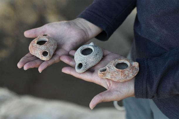 The stash of ancient clay oil lamps were found next to a buried water cistern, which led experts to believe this could be the location of the lost Beit Natiff lamps. (Israel Antiquities Authority)