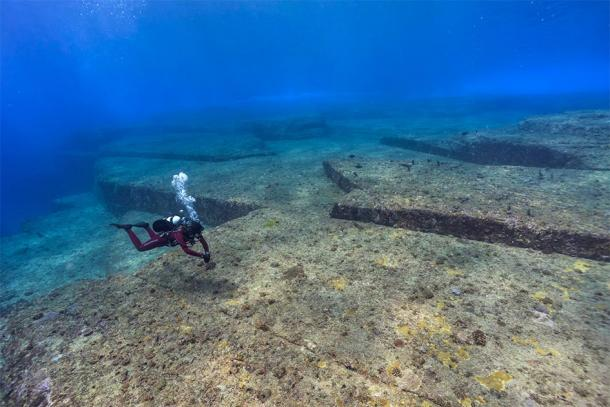 A diver inspecting the underwater site of Yonaguni, a key site in megalithic Japan. (hoiseung jung/EyeEm / Adobe stock)