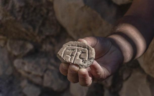 Seal made from clay discovered in the excavation of a parking lot in Jerusalem may provide clues as to the resettlement of the city by the Jews after the Babylonian Exile. (Shai Halevy / Israel Antiquities Authority)
