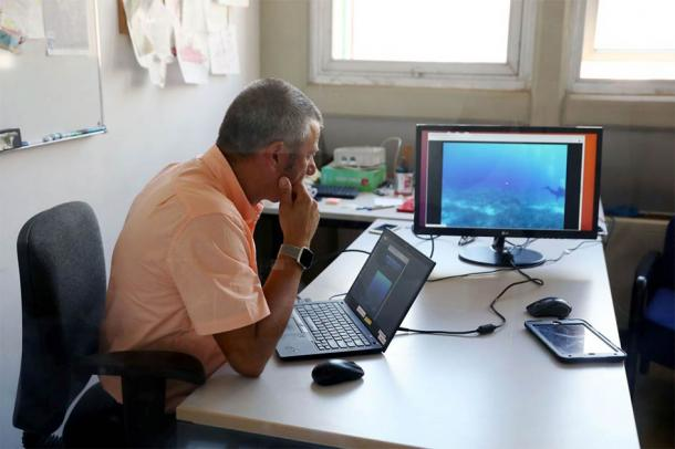 Lead researcher George Papalambrou viewing the site where the underwater AI robots stand guard (NOUS)