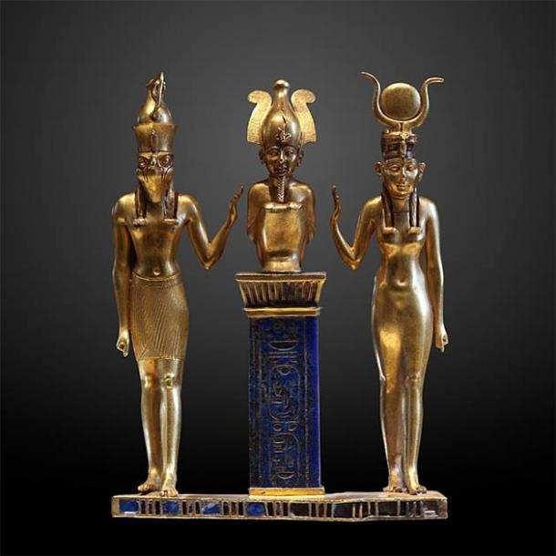 The family of Osiris: Osiris on a lapis lazuli pillar in the middle, flanked by Horus on the left and Isis on the right (Louvre Museum / CC BY-SA 2.0 FR )