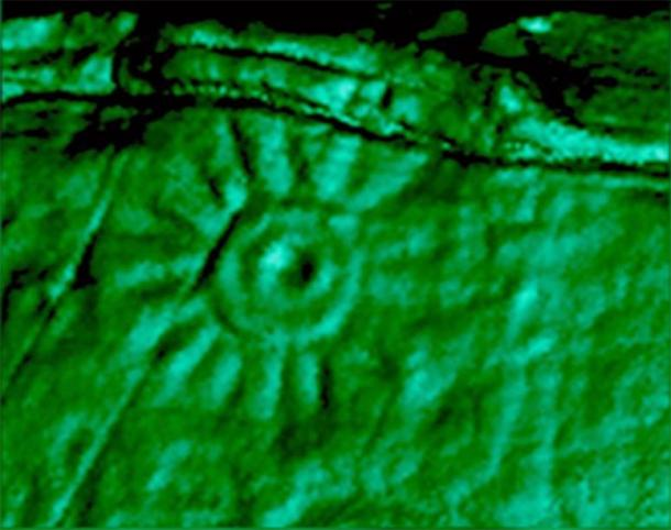 A close-up image of one of the carvings on the Peruvian monolith that was 3D scanned. The engraving has a hole in the centre and lines radiating from the circle. (Daniel Fernandez-Davila / Exact Metrology)