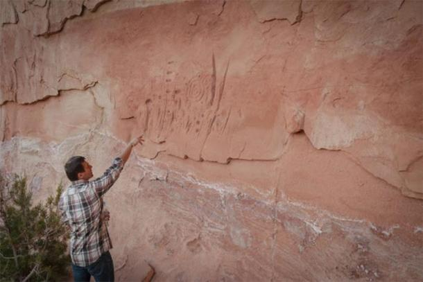 Polish archaeologist analyzing some of the Pueblo people's rock art found at the Mesa Verde site in Colorado. (Jagiellonian University)
