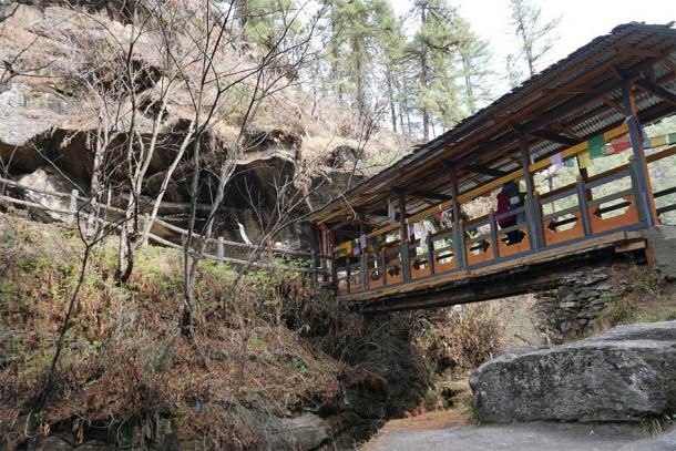 An ancient bridge that crosses over the gorge at Bhutan's Burning Lake. (David / Adobe Stock)
