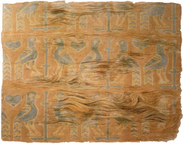 The motive on this Viking burial textile, a pillow, found in one of the reliquaries in Denmark shows birds, probably peacocks, flanking a stylized tree or cross. It consists of several silk pieces sewn together. Source: The National Museum of Denmark