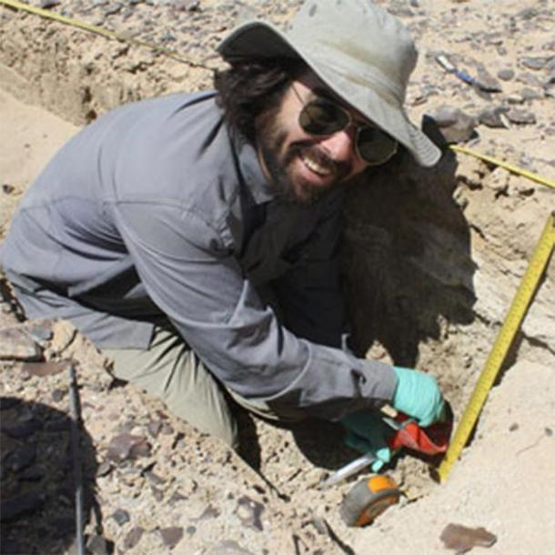 UC Berkeley archaeologist A.J. White digs up sediment in search of ancient fecal stanols of Cahokia tribe. (Danielle McDonald)
