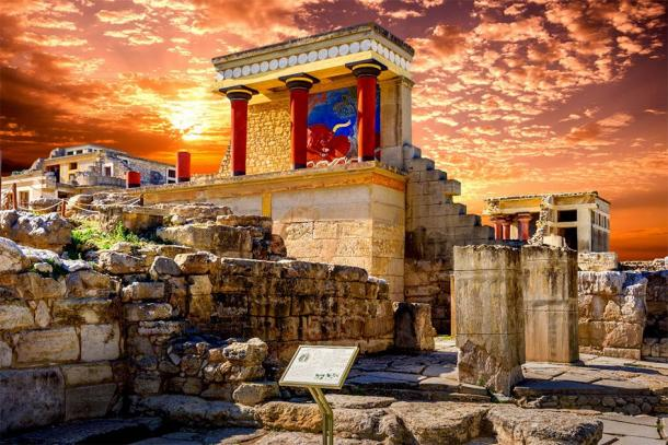 The north entrance of the Knossos Palace and the charging bull fresco in Crete, Greece.