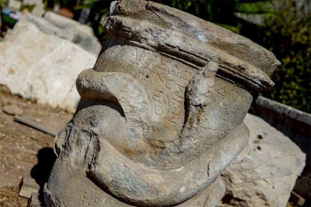 A closeup of the Greek snake altar recently found in Patara, Turkey showing the Greek writing on the altar more clearly. (AA)