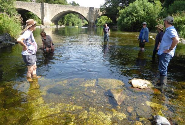 """The """"lost"""" medieval bridge was discovered by a multi-disciplined community of Scottish history lovers, seen here wading in the River Teviot. Thanks to their dedication, the Ancrum Old Bridge dating back to the 1300s was discovered in the Scottish borders. (ADHS)"""
